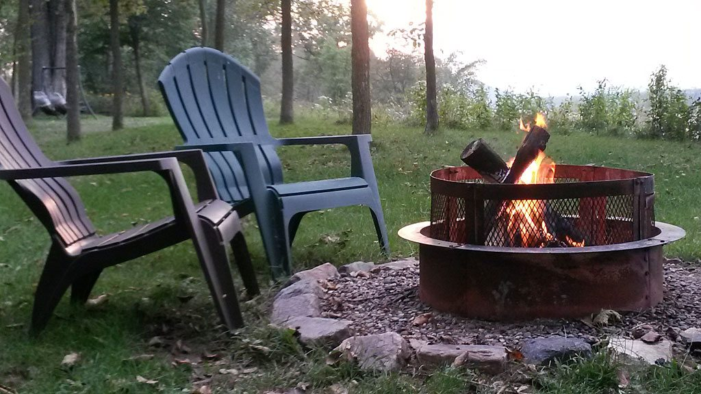 Come sit in these chairs with a fire along the Wisconsin River
