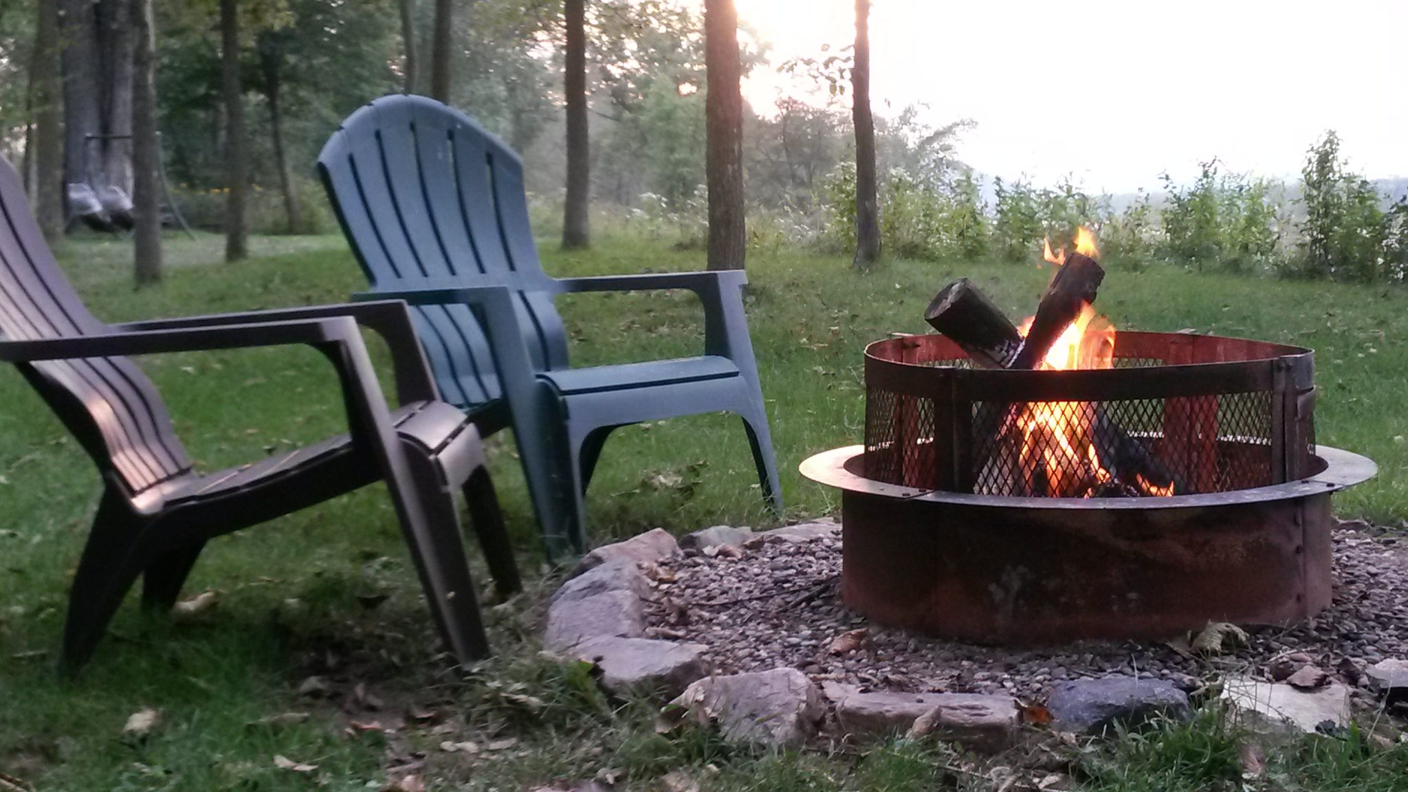 Come sit in the chairs with a fire along the Wisconsin River